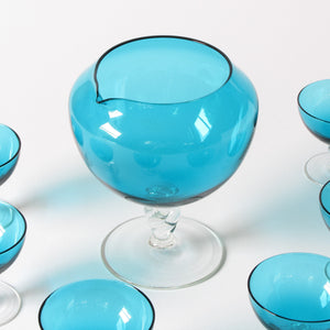 Blue art glass decanter and martin glasses close up