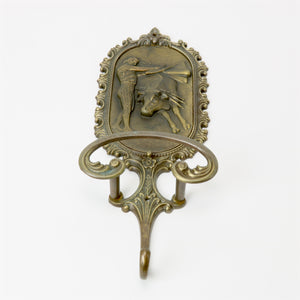 Brev brass coat hanger with bull and matador