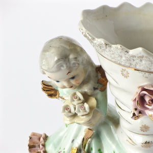 Estate figurine vases in porcelain closeup of child and boot