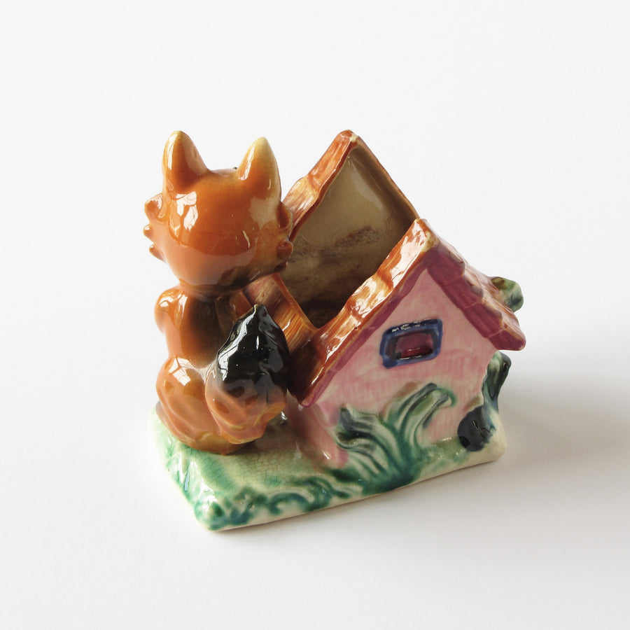 Antique ceramic fox planter with checked glaze