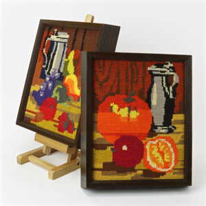 Framed needlepoint art canvases with still life fruit