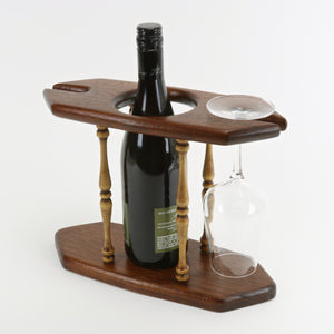 Solid teak wine caddy shown with wine bottle and glass