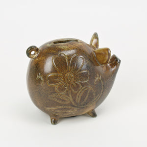 Ceramic Japanese piggy bank in brown and rust glaze back view