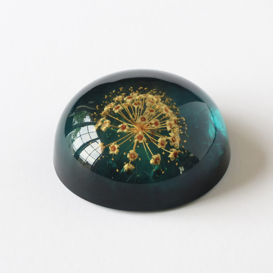 Blue acrylic Jeanne Ocker paperweight with flower