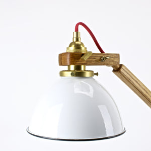 White enamel shade with brass socket on mid century oak lamp