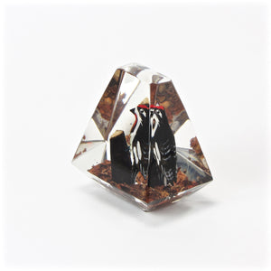 Acrylic woodpecker paperweight side view