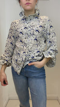 Load and play video in Gallery viewer, Crean and blue moon and stars print blouse- size M