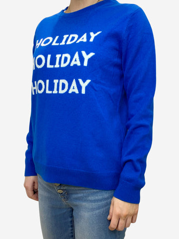 Blue woollen jumper with 'Holiday' writing on the front - size S