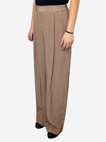 Nude wide leg silk elastic waist trousers with navy and red pattern- size M