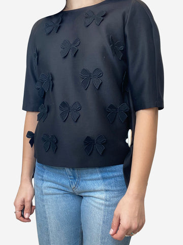 Black boxy fit blouse with bow detail accents and open button back- size UK 8
