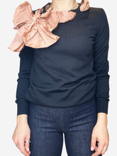 Load image into Gallery viewer, Black long sleeve sweater with frayed ribbon bow neckline- size M