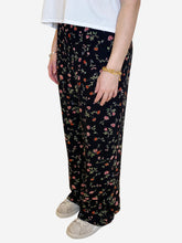 Load image into Gallery viewer, Black floral Black floral wide leg chiffon trousers - size L