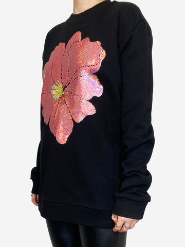 Black pullover with pink sequin flower- size M