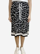 Load image into Gallery viewer, Black and white sketched logo midi skirt- size UK 10