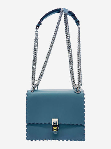 Blue grey crossbody bag with rust leather edging and silver metal chain