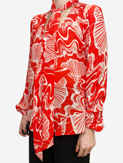 Red and cream printed Moss blouse with neck tie- size UK S