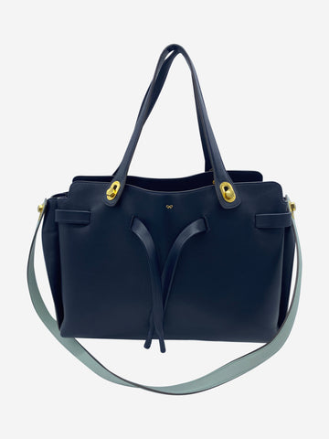 Navy structured tote bag with multiple interior dividers
