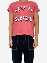 "Load image into Gallery viewer, Pink ""Keep It Surreal"" distressed t-shirt - size XS"