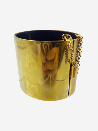 Thick gold cuff with leather lining