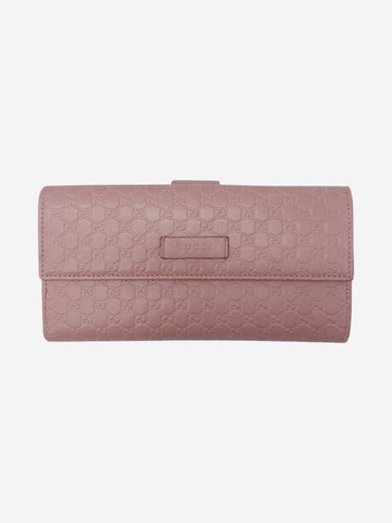 Pink Monogram embossed leather wallet