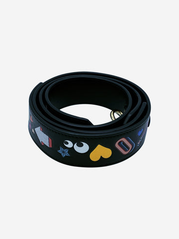 Black leather bag strap with stickers and gold hardware