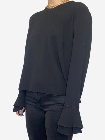Black long sleeve ruffle cuff blouse - size M