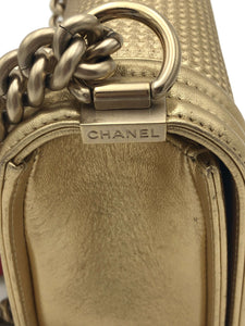 Chanel Gold Cube embossed leather boy bag