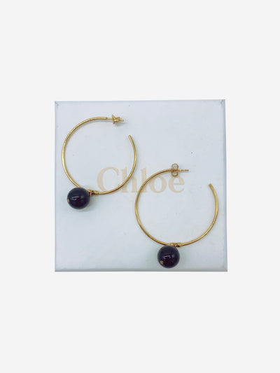 Gold hoop earrings with black bead