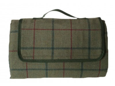 A pale green, tweed picnic blanket with a carrying handle.
