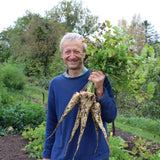 Charles Dowding showing produce from his No Dig vegetable garden