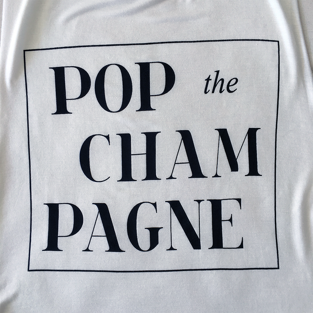 Sleeveless Pop the Champagne Shirt in White