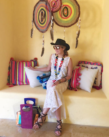 Andria Mitsakos, founder and creative director of Wanderlista wearing Miguelina and her Greek Market Jennet Pendant. Sostis bag featured here in metallic rose