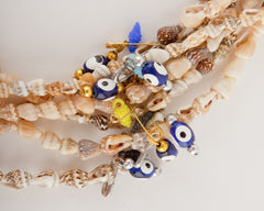 WANDERLISTA <br> Fiji Shell Necklace With Evil Eye Charm