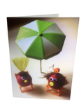 Radish couple under an umbrella