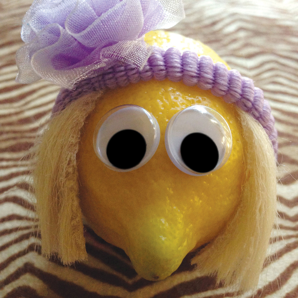 A lemon character with wig and headband