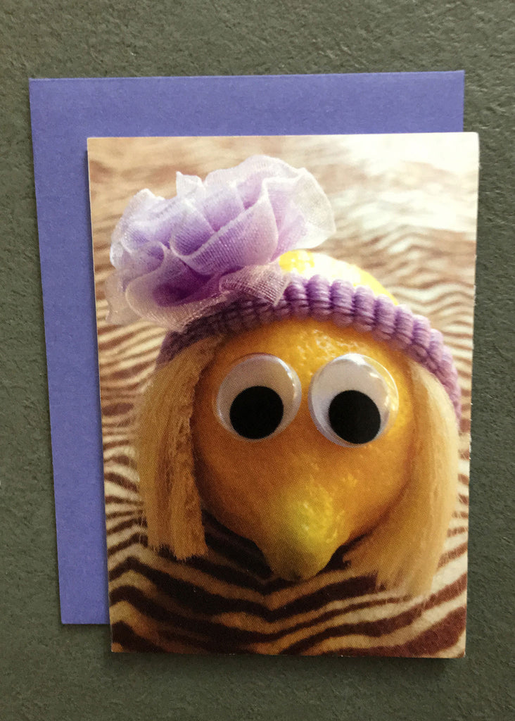 Lemon character with purple headband on gift enclosure card