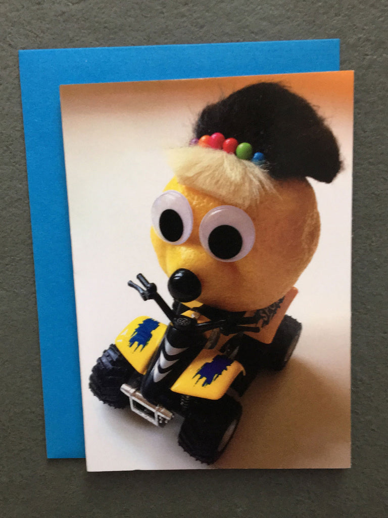 Lemon character riding an ATV on gift enclosure card