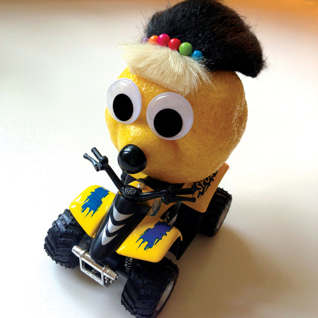Lemon character riding a ATV