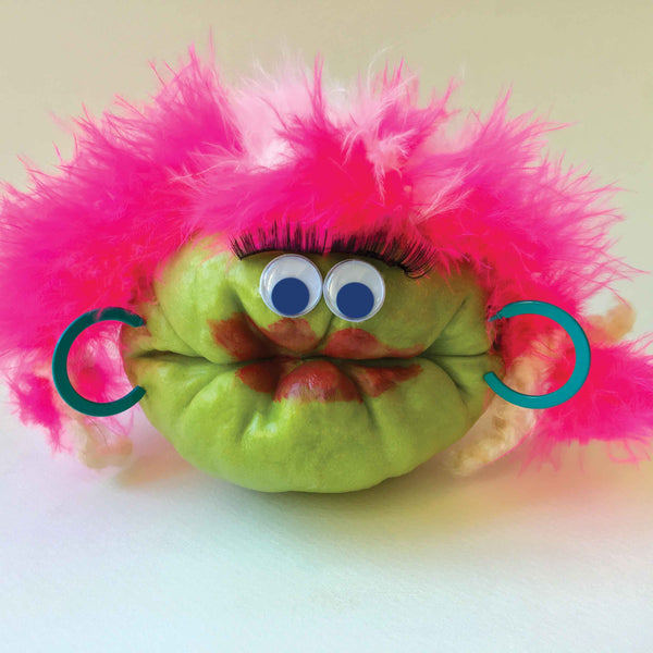 Chayote squash character with pink wig and earrings