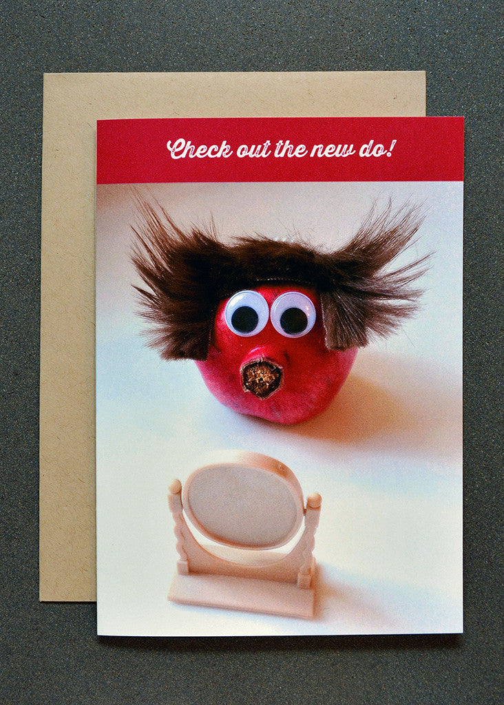 Pomegranate character with wig looking in mirror greeting card