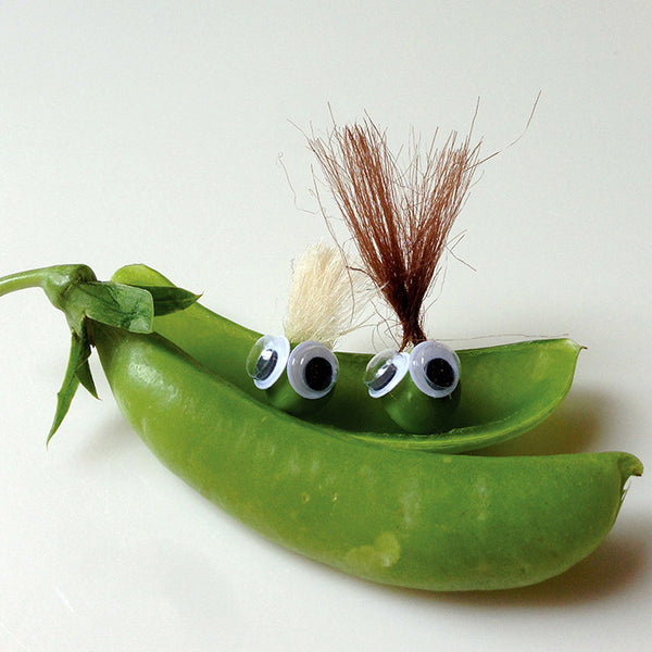 Two pea characters sitting in a pod