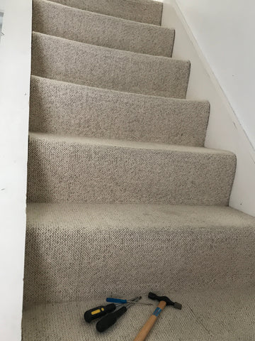 Old cream stair carpet