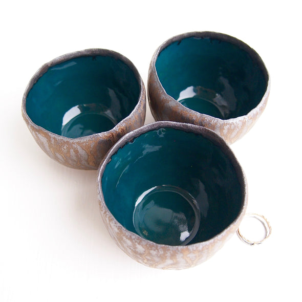 three Teal and gold pottery ring bowls