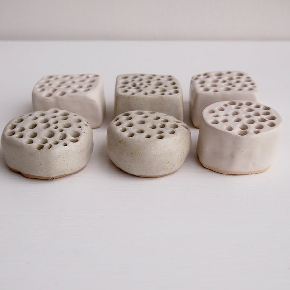 round and square pottery flower holders