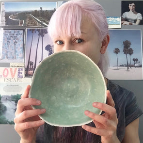 Me holding turquoise and white bowl