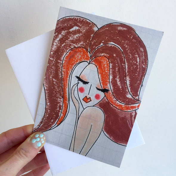 holding red hair girl birthday card with envelope