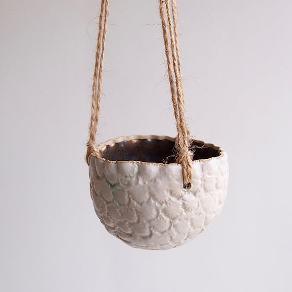 Handmade round white textural small hanging planter with gold inside