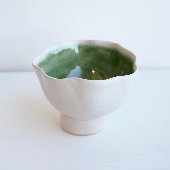Handmade green and satin white ceramic ring dish with a cylinder base