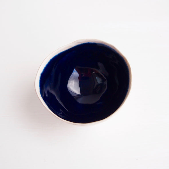 Handmade navy and satin white ceramic ring dish with a cylinder base