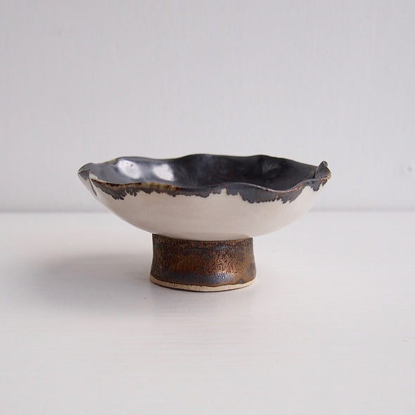 Handmade black/gold and satin white ceramic ring dish with a gold/black cylinder base